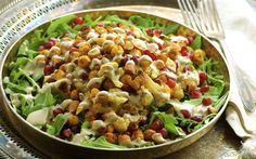 <p>Tender, caramelized roasted cauliflower and crispy spiced chickpeas on a bed of spicy fresh arugula, provide a balance between roasted and raw vegetables. </p>