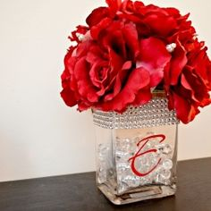 This gorgeous and elegant DIY centerpiece is perfect for the head table at a wedding or for your own table at home.  Tutorial provided.