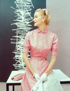 Sunny Harnett wearing a pink, silk shantung dress, 1954