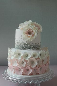 Weddbook is a content discovery engine mostly specialized on wedding concept. You can collect images, videos or articles you discovered  organize them, add your own ideas to your collections and share with other people - Weddbook ♥ Vavi's Cakes,its consists of beads and flowers looks pretty and lovely.amazing cakes and tastes yummy so please don't miss it for your wedding.