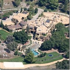Will Smith lives in a refurbished castle in Calabasas, California.    Truly exclusivist and luxurious, this little castle is estimated at $20 million, and of course it comes with its own lake and huge sports arenas such as an ultra modern tennis court & basketball field. Together with his beautiful wife Jada-Pinkett Smith and their children, they enjoy all the luxuries money can buy in this fairytale castle, which by the way, has its own zip code!