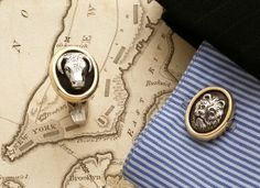 "Wall Street inspired Bull and Bear cufflinks in sterling silver and 14kt gold.  5/8"" x 3/4"""