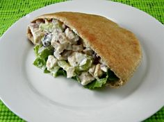 Clean Eating Chicken Salad::2 cooked skinless, boneless chicken breasts - cut into cubes 2 celery stalks, chopped 1/4 red onion, chopped 1/2 cup red seedless grapes, quartered 1/2 cup Greek yogurt, non-fat 1 tsp garlic powder 1 tsp freshly ground black pepper Sea salt to taste 2 whole-wheat pita pockets, halved 4 romaine lettuce leaves