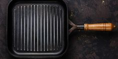 GET IT CLEAN: Clean grill pan just like cast iron cookware. If you don't have a grill brush, make a quick, disposable scrubber by balling up a sheet of aluminum foil. Use the ball to scrape the pan's ribbed grate. Use coarse salt and water to attack caked-on grit. After the surface is clean, wipe down the pan with paper towels. Heat the pan over medium until it's very dry. Finally, rub down the surface with an oil-covered paper towel and heat for another 5 minutes, then let cool.