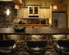 Love the stone walls & concrete countertop. Could be great for a basement.