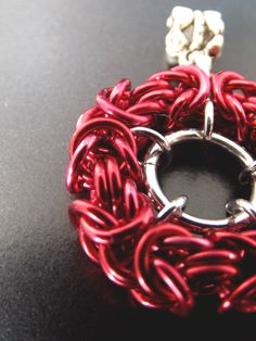 Red Pendant by Aberrant Ginger. Perfect bright red for the coming winter months. Australian based chainmaille jewelry.