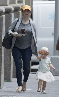 Spotted: Chelsea Clinton and her daughter Charlotte were seen heading into the car outside...