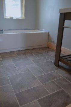 Barn bathroom laminate floor2 -- I want this vinyl flooring in my renovated master/main bathroom!!!