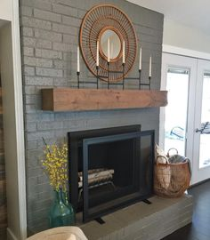 to Paint a Brick Fireplace (and the Best Paint to Use!) This color of grey and fireplace screen. How to Paint Brick, Painted Brick FireplacesThis color of grey and fireplace screen. How to Paint Brick, Painted Brick Fireplaces Painted Brick Fireplaces, Grey Fireplace, Brick Fireplace Makeover, Home Fireplace, Fireplace Design, Fireplace Ideas, Painting A Fireplace, Fireplace Furniture, Brick Fireplace Remodel