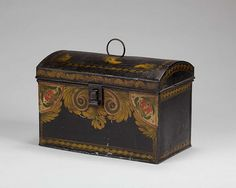 AMERICAN PAINTED TINWARE DOME-TOP TRUNK WITH SCROLL AND FLORAL DECORATION. http://www.artfact.com/archives