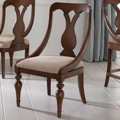 American Drew Fulton County Sling Back Dining Side Chairs - Set of 2 by American Drew. $539.98. Enjoy the modern elegance of the American Drew Fulton County Sling Back Dining Side Chairs. This set of two chairs is quality crafted from hardwood solids with a rich cherry veneer and given a Burnished Antique Cherry finish. Each chair features soft curves with a traditional-style back. Arms gracefully flow down to the seat, giving a visually striking contrast between contemp...