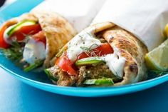 Slow Cooker Chicken Gyros are the ideal weeknight meal when you want something different, but that supports your health and weight loss goals! #gyros #chickenrecipes