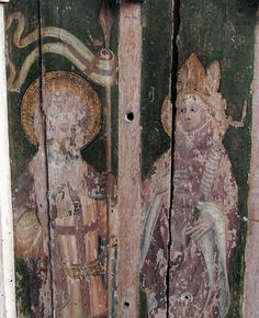 St George and St Erasmus.The ghostly remains of a medieval masterpiece - the chancel screen at Hempstead church, near Stalham, Norfolk. c 1400