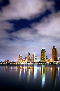 San Diego Skyline from Coronado A another Beautiful Blending of water and sky and the City scape that is shining. Idaho, Wyoming, Nevada, Wonderful Places, Beautiful Places, San Diego Skyline, Visit San Diego, Arizona, Night Skyline