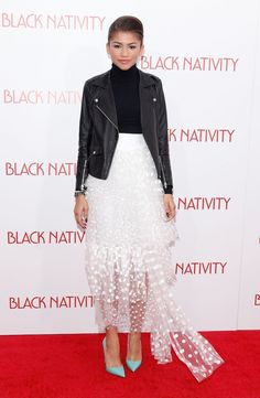 Zendaya pulls off so many chic elements in this one look: the polished black turtleneck, the tough moto jacket, the romantic white skirt and the playful colored heels!