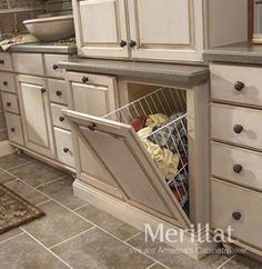 master bathroom laundry hamper/cabinet~I would absolutely LOVE this in our home bathroom, considering someone leaves their clothes on the bathroom floor ALL the time ;)
