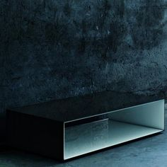 GLAS ITALIA - SIO2 TUNNEL GLASS COFFEE TABLE This collection of coffee tables comes double plated in coupled laminated glass. Available in two size and shape options both in lacquered and opaque satin glass, with the possibility to combine freely the colour of the inside with the colour of the outside. The table rests on small feet in aluminium that confer an impression of weightlessness.