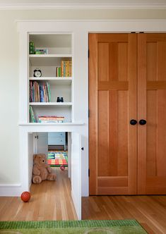 Custom built-in bookcases featuring a secret passage between the children's rooms. Alyssa attempted this by knocking the wall down between her closet and Lauren's! Secret passage way for big girls!