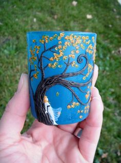 LOVE LOVE the work by this artist. She uses old glassware (saving it from the landfill) and creates these whimsical, incredibly detailed candle holders and vases.