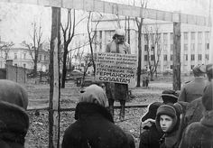 """Nurse at the Scherbatsevich hospital, Olga Fedorovna, hanged by the Germans in Alexander Square in Minsk, October 26,1941. The inscription on the poster hanging around her neck reads in Russian and German - """"We are partisans, shooting at German soldiers."""""""