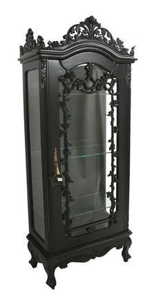 I love this old kind of creepy Victorian gothic furniture.  We could fill it with awesome things.