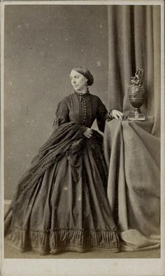 CDV: Woman wearing a hooped dress & shawl by London Stereoscopic c.1865