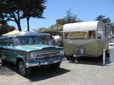 "Gorgeous teal ""cheese grater"" Wagoneer with an old Shasta camper."