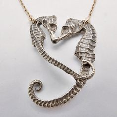 One of the more gender-equality geared animals of the undersea kingdom, the male seahorse actually carries around the eggs until they mature and a bunch of itty bitty baby seahorses spring into the ocean from his pouch. This necklace celebrates that egalitarian love, with two equine ocean creatures coiled together in the shape of a heart.
