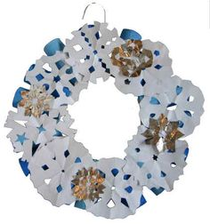 Snow Flake Wreath!  All you need is TP rolls, an old hanger and hand made snowflakes. Perfect for this time of year.