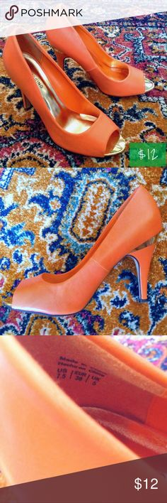 """Call It Spring Bright Orange Open Toe Heels Orange open toe heels with gold accents by Call It Spring. The heel is 4"""" tall with a gold metallic strip and the body is a faux leather material. There is a seam down the back and at the sides. There are minor flaws, as shown in the last picture. 1: the padding is loose at the toe, but can be glued down (comment if you want me to glue it for you prior to shipment). 2: black scuff on outside. 3: small tear on inner heel. Size is 7.5, but fits more…"""