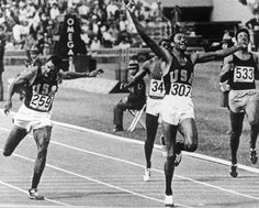 Smith and Carlos, the 200m gold and bronze medallists, don black gloves and give the Black Power salute on the podium in Mexico in 1968