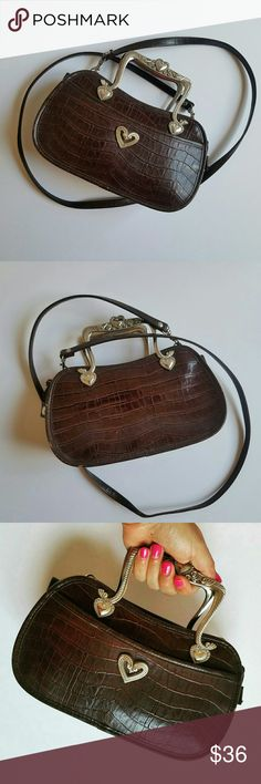 Vintage Western Purse Faux leather. Great Condition. Minor Flaws on side of purse. See last pic. Metal/Silver accents. Adjustable Strap. Shoulder purse or hand bag. Brown checker interior lining. Needs a lil cleaning. Ive never used. Bought as it is. Just a Lovely Staple!! Offers Welcome :) Bags