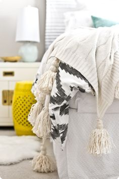 DIY Home Decor   Add chunky tassels to a throw to give it a totally new look - inspired by Anthropologie!