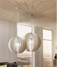 White wooden pendant with slat detailing to show the bulb in an oval shape. Two larger diameter pendants are also available in this range. Slats, Bleached Wood, Pendant Lamp, Wooden Pendant, Bulb, Globe Pendant, Pendant Light, Pendant Lamp Shade, Ceiling Lights