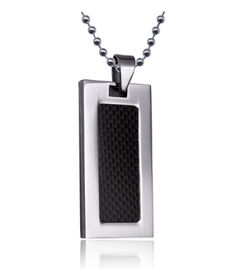 Stainless steel pendant featuring a sleek black carbon inlay on the front.