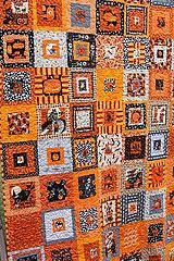 One year, Betty Dennany and Angie Newton made Halloween Quilt. Now Rebecca Lamper is our quilt artists.