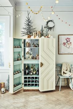 For the tiny middle room--something like this?  Geo Ripple Bar Cabinet | Anthropologie
