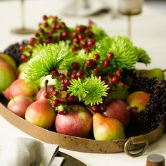 BH - Tray with Fall Fruits  Dress up your dining table -- without hindering conversation -- by making a festive, low-profile centerpiece. Cut branches of hypericum berries and chartreuse spider chrysanthemums short enough to just peek over the tops of several glass vases; then arrange them down the center of a long tray. Fill out the rest of the tray with apples, pears, and bunches of elderberries to create an abundant display.