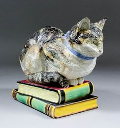 Lot 429 - A Late 19th Century Brown-Westhead and Moore majolica model of a cat with a blue bow sitting on