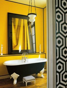 retro b wall paper, mustard yellow walls and black tub w/ claw legs & mediterranean lighting fixture -- why not? #love # design