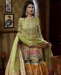 Embroidered flourishes on earthy tones with playful pink and yellow accents, this Noor Mahal piece emanates fine eastern couture. Pakistani Mehndi Dress, Bridal Mehndi Dresses, Mehendi Outfits, Bridal Dress Design, Pakistani Bridal Dresses, Pakistani Wedding Dresses, Pakistani Dress Design, Pakistani Outfits, Bridal Outfits