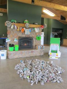 Decorations for garbage truck party. Love the recyclable banner and the newspaper flowers.