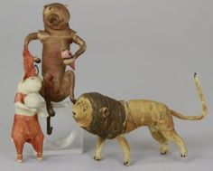 Three spun cotton antique ornaments; bear, lion, and ...?