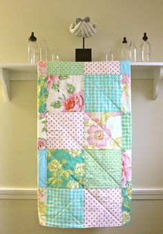 Baby Girl Quilt -  Pastel Roses  - Patchwork in Aqua and Pink fabrics by Heather Bailey and Amy Butler. $89.00, via Etsy.