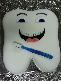 Dental hygiene graduation cake. Face is kinda creepy, but none the less cool