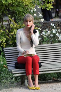 Taylor Swift - red skinny pants, yellow flats