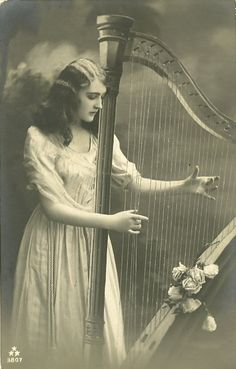 Girl With Harp by ~HauntingVisionsStock on deviantART.  Alright.  THIS bothers me.  Let's all just go play the harp BACKWARDS...