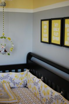 Love the You are my sunshine above the bed. Yellow and grey color scheme