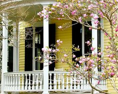 yellow house...pink flowers...