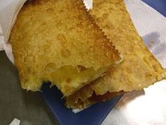 Yummy Street Food (junk food) called Pastel. Fried dough with different fillings like cheese and ground beef.